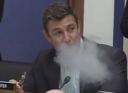 Rep. Duncan Hunter vapes during congressional hearing.