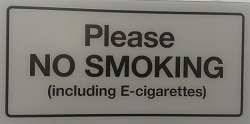 """Please no smoking or vaping"" sign"