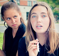 Teenagers vaping electronic cigarette